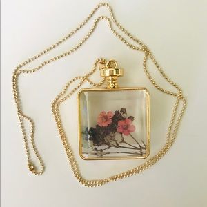 Perfume bottle necklace with dried flowers